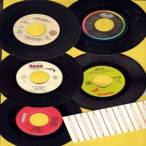 David, F. R., Paper Lace, David Dundas, Duran Duran, Dire Straits - Euro-Pop 5-Pack: 5 first issue 45rpm records originating in England, then becoming world hits, all in very good or better condition, shipped in plain paer sleeves with strip of 5 blank ju