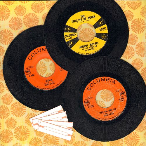Mathis, Johnny - 3-Pack of first issue 45s includes hits The Twelfth Of Never, Gina and What Would Mary Say (shipped in plain white paper sleeves with 4 blank juke box labels) - VG7/ - 45 rpm Records