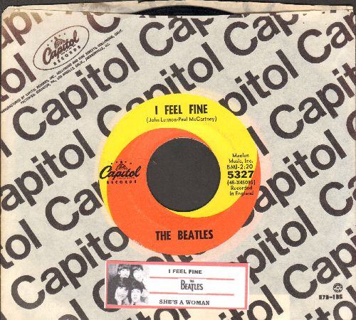Beatles - I Feel Fine/She's A Woman (orange/yellow swirl first issue with juke box label and Capitol company sleeve) - NM9/ - 45 rpm Records