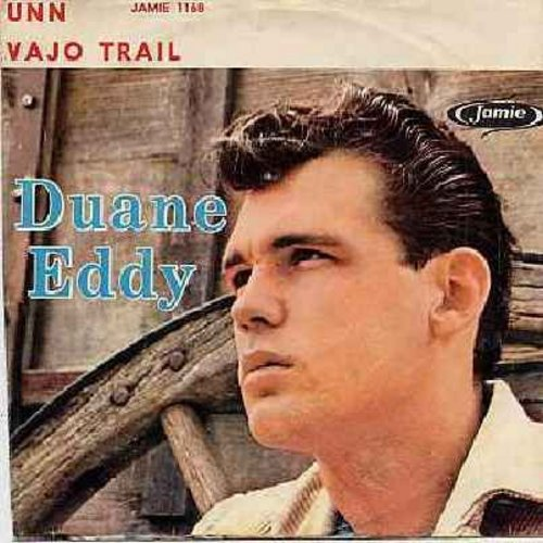 Eddy, Duane - Peter Gunn/Along The Navajo Trail (with picture sleeve, has odd manufacturing error, title over Duane Eddy's picture seems pulled to the left, while picture is perfectly centered - VERY unique!) - EX8/VG7 - 45 rpm Records