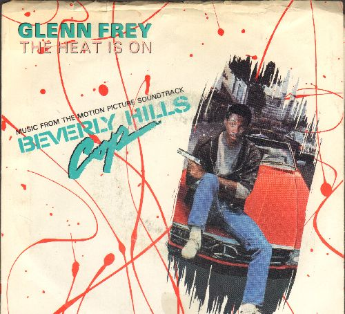 Frey, Glenn - The Heat Is On (from film -Beverly Hills Cop-)/Shoot Out (by Harold Faltermeyer) also featured in film -Beverly Hills Cop- (with picture sleeve) - NM9/VG7 - 45 rpm Records