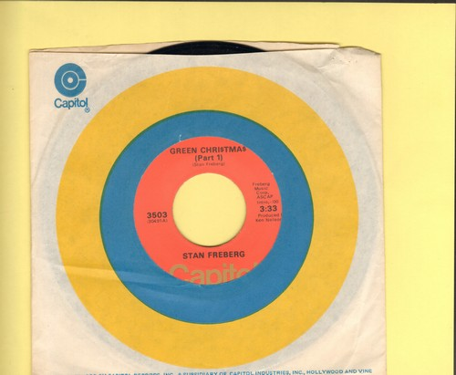 Freberg, Stan - Green Chri$tma$ (Parts 1 + 2) (orange label 1970s issue with Capitol company sleeve) - EX8/ - 45 rpm Records