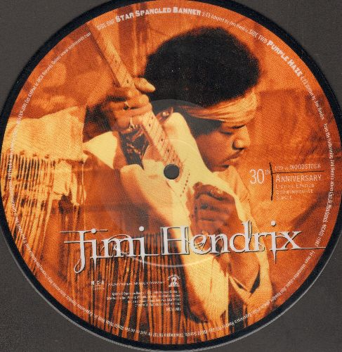 Hendrix, Jimi - Jimi Hendrix 30th Anniversary LIVE At Woodstock - 45 rpm Picture Disc, MINT condition in original plastic pocket-sleeve. - M10/ - Picture Disc