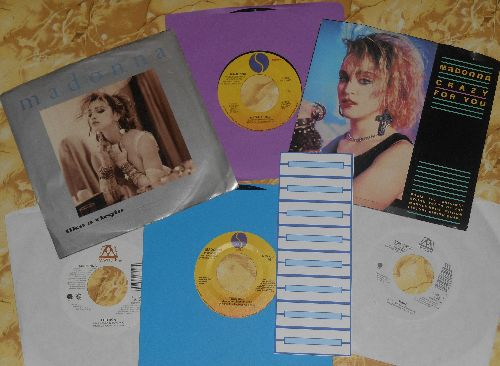 Madonna - Madonna 6-pack of first issue 45s, 2 with picture sleeve (exactly as pictured). Includes 8 blank juke box labels. GREAT as gift for a fan, a themed party or a Juke Box! - EX8/VG7 - 45 rpm Records