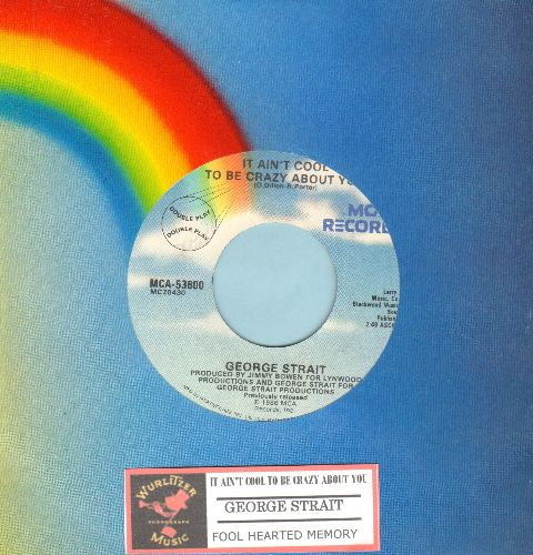 Strait, George - It Ain't Cool To Be Crazy About You/Fool Hearted Memory (authentic-looking double-hit re-issue with juke box label and MCA company sleeve) - NM9/ - 45 rpm Records