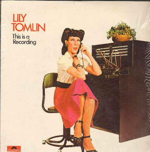 Tomlin, Lily - This Is A Recording: The Best of Ernestine Tomlin, the Phone Company's own, the Omnipotent, the high school graduate!  (Vinyl LP record, GRAMMY WINNER - BEST COMEDY ALBUM! - with shrink wrap) - NM9/NM9 - LP Records