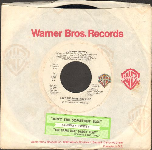 Twitty, Conway - Ain't She Somethin' Else/The Games That Daddies Play (with juke box label and Warner Brothers company sleeve) - NM9/ - 45 rpm Records