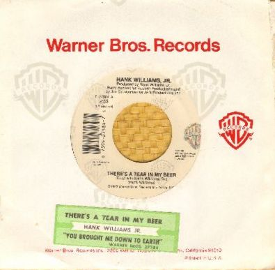 Williams, Hank Jr. - There's A Tear In My Bear/You Brought Me Down To Earth (with Warner Brothers company sleeve and juke box label) - EX8/ - 45 rpm Records
